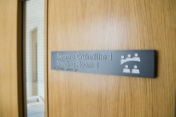 Health sector - Applewood Community Centre meeting room door sign with tactile and braille