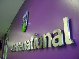 Educational signage- Branding -UCD International internal stainless steel lettering and logo