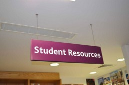 Educational signage - UCD International student resources suspended sign