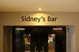 Actons Hotel Sidneys Bar internal lettering sign