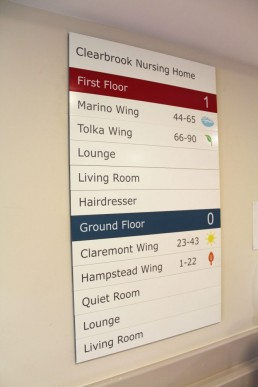 Nursing home signage - Clearbrook Nursing Home directory wall sign with graphics and icons